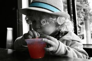 child drinking a sugary drink