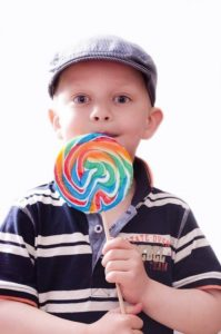 kid with a large lollipop